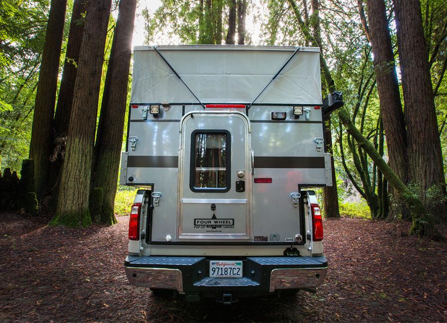 Woolrich-special-edition-four-wheel-camper-hawk-front-dinette-slide-in