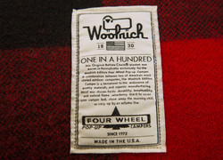 Woolrich-special-edition-four-wheel-camper-hawk-front-dinette-lable-1-in-100