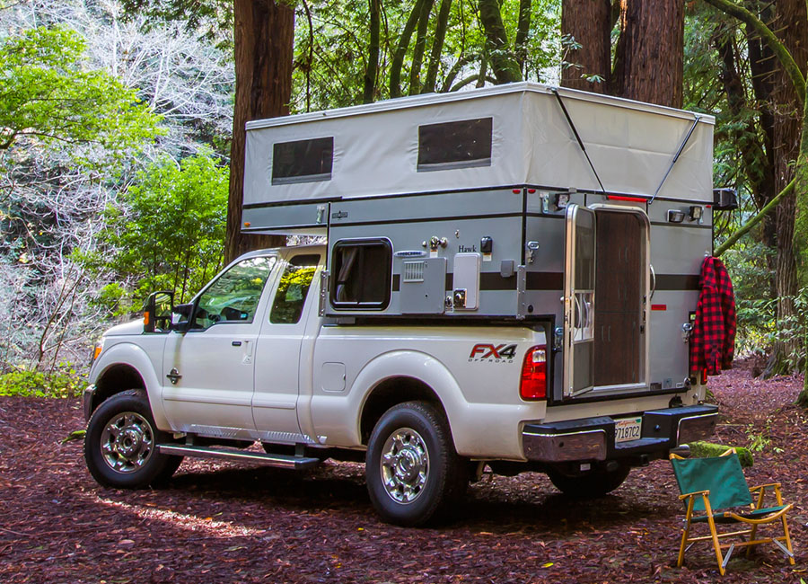 Woolrich-special-edition-four-wheel-camper-hawk-front-dinette-slide-in-exterior
