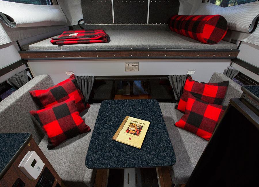 Woolrich-special-edition-four-wheel-camper-hawk-front-dinette-slide-in-interior