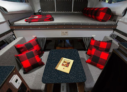 Woolrich-special-edition-four-wheel-camper-hawk-front-dinette-slide-in-interior