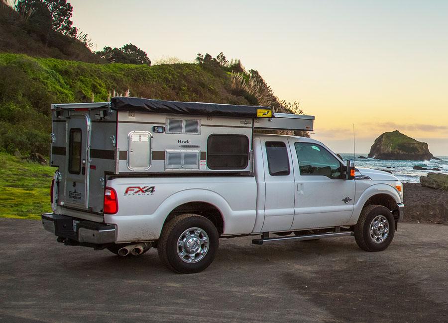 Woolrich-special-edition-four-wheel-camper-hawk-front-dinette-slide-in-passenger-side