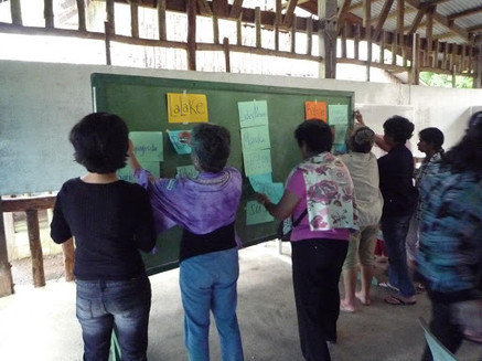 Teaching marginal women fisherfolk on Gender and Development.jpeg