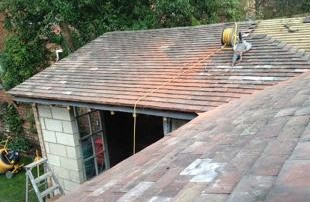 tiling to shallow roof - membrane underneath catches any leakage due to shallow pitch