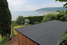 Outdoor room overlooking the ocean with onepiece rubber membrane roof