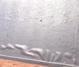 I've got bubbles (blisters) on my new Rubber Roof. Why?