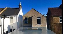 fibreglass flat roof kit installed with skylightroof.jpg