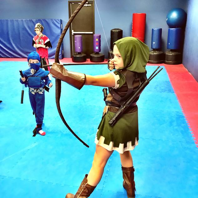 Robin Hood aims her bow, beware of her crosshair!