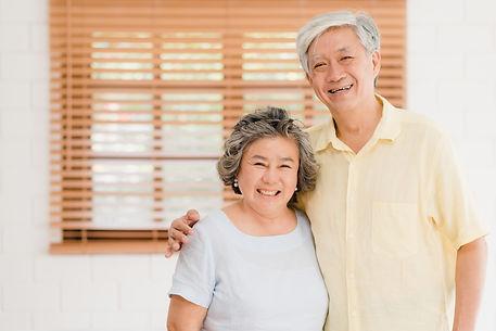 asian-elderly-couple-feeling-happy-smili