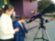 With a child looking through a telescope
