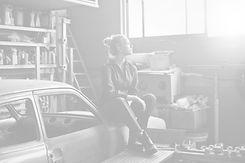 woman sitting on orange vehicle_edited_edited.jpg