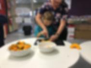 Alex - cutting pumpkin.JPG