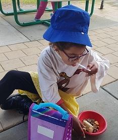 Grace tasting kangaroo stew (3) cropped.
