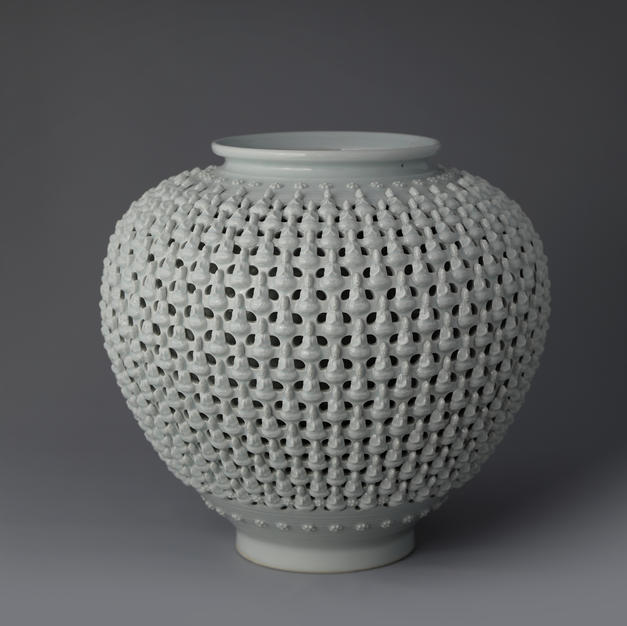 Double Open-work Porcelain Vase with Buddha Decoration