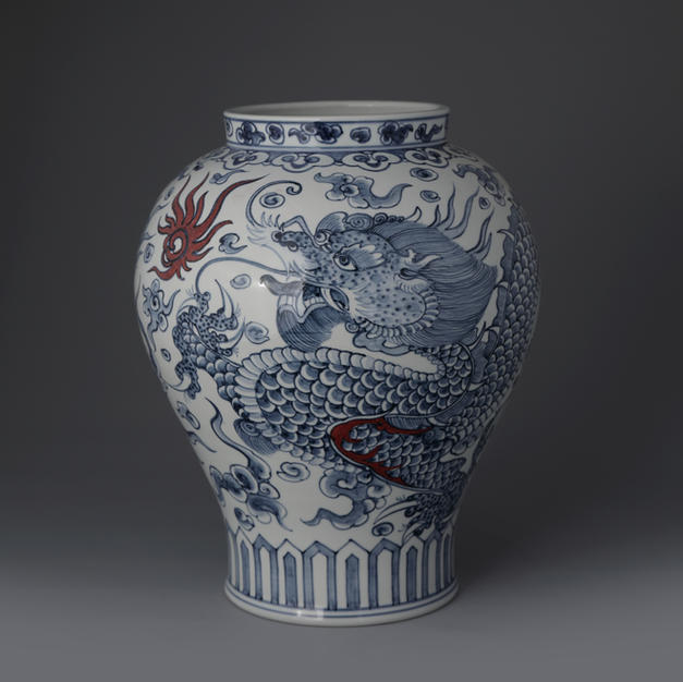 White and Blue Porcelain Vase with Dragon Decoration