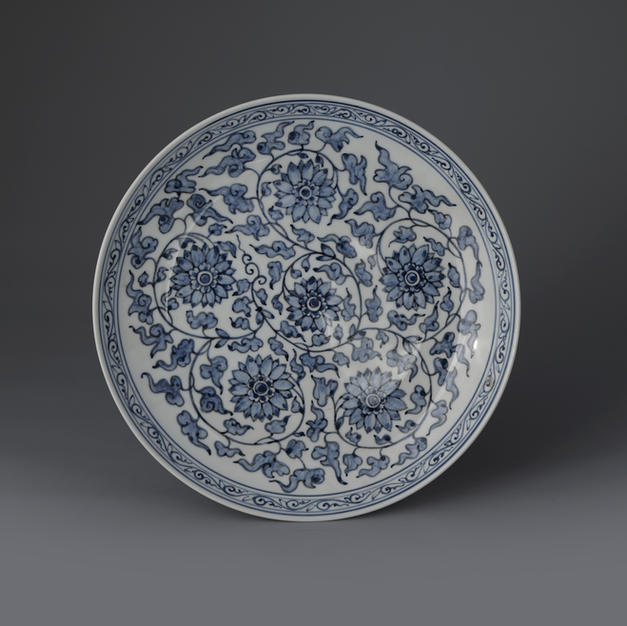 White and Blue Porcelain Plate with Arabesque Design