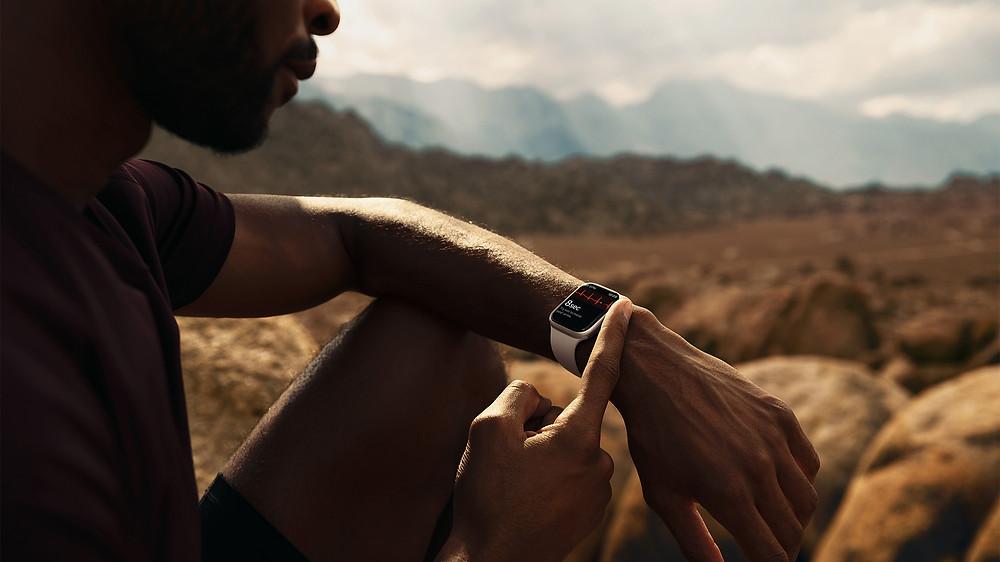 Apple Watch Series 7 on man standing in California.