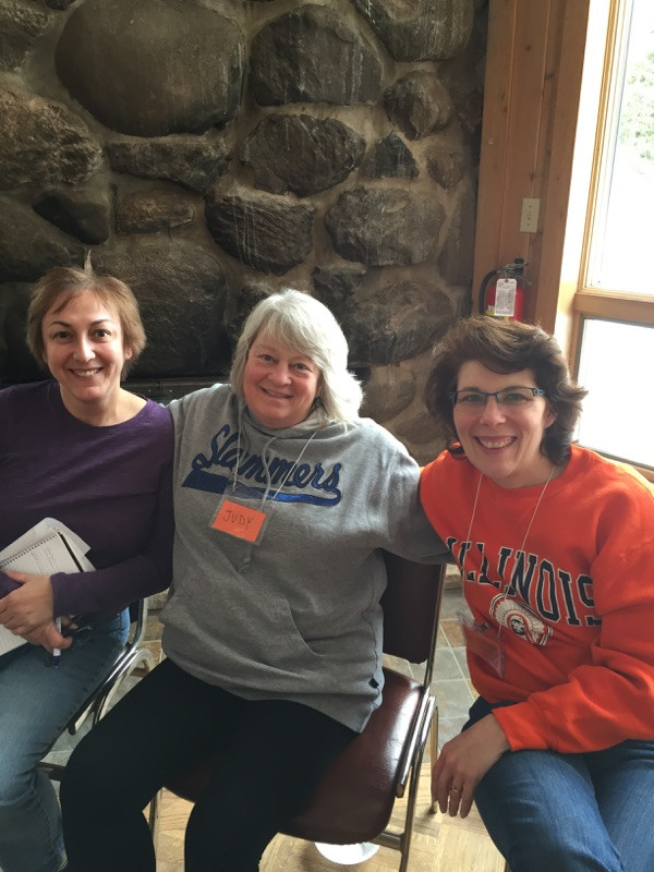 Marlene in orange sweater with friends at the Women's retreat