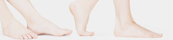 Two pairs of bare feet