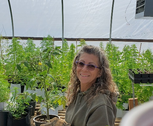 Jana planting in her Carhartt's