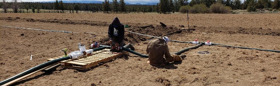 Scott and Corbin laying irrigation