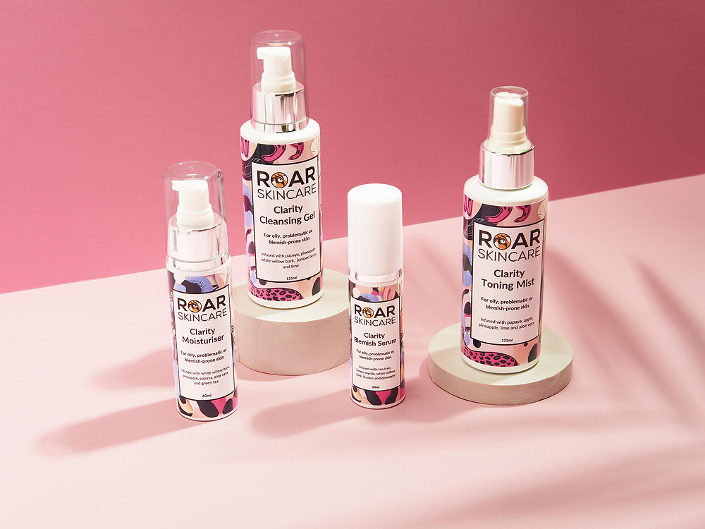 Roar Skincare beauty products on pink backgrounds with soft shadows to create optical depth