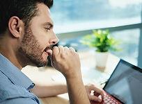 anxious-businessman-biting-nails-working-with-lapt-2021-04-02-19-18-22-utc.jpg
