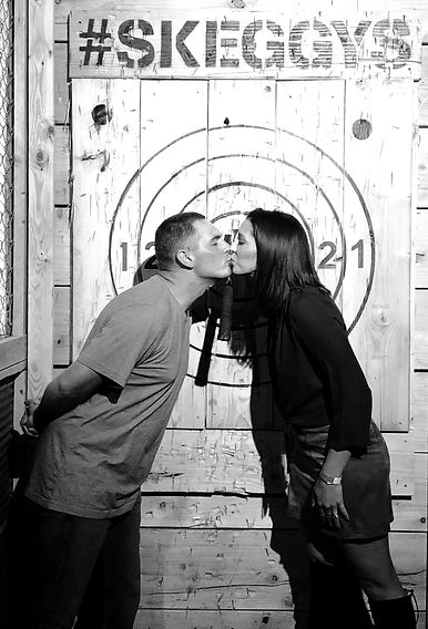 Couple kissing after throwing axes at Skeggy's Axe House in Easton, PA