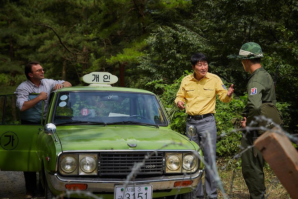 Cena do sul-coreano O Motorista de Táxi (2017) | Foto: Divulgação (Mostra SP)