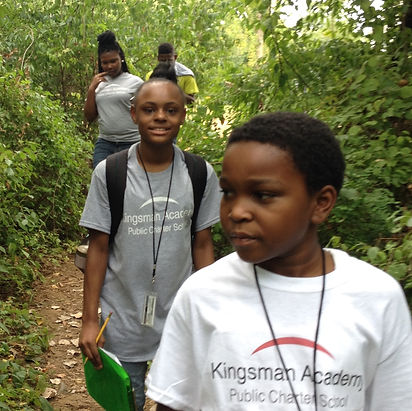 Kingsman Academy Middle School students walk on a hiking trail during a field trip.