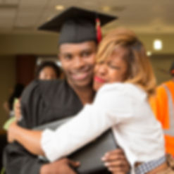 A proud mother hugs her son after the Kingsman Academy graduation ceremony.