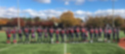 The Kingsman Academy football team poses for a group photo.
