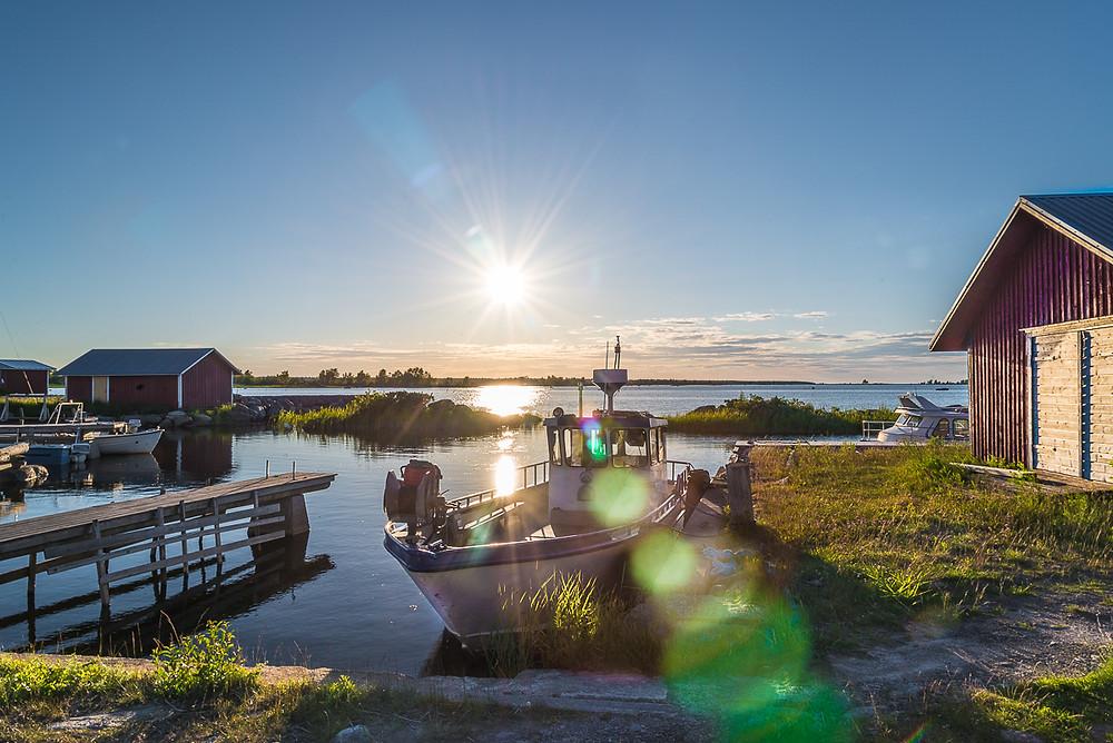 boat anchored on summer night in Replot, Kvarken on western Finland