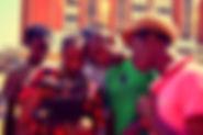 slumtv training. Group of students around a camera