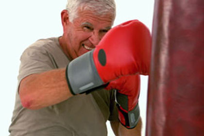 senior man hitting bag.jpg