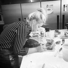 Camilla decorating a cake