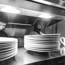 Nicola - head chef working the pass at a wedding
