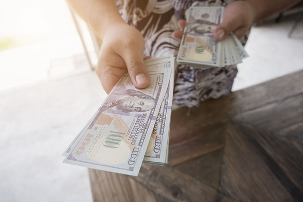 handing over cash.jpeg