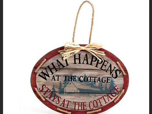 """WHAT HAPPENS AT THE COTTAGE"" SIGN"