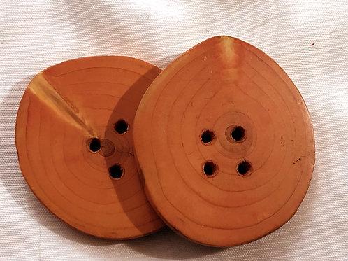 Boutons orangés