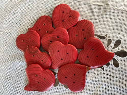 Boutons coeur rouge