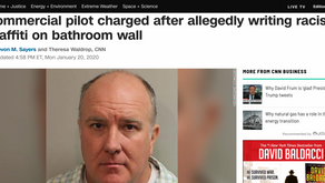 Commercial pilot charged after allegedly writing racist graffiti on bathroom wall