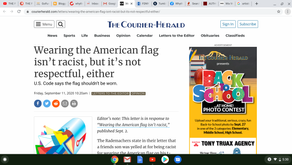 Wearing the American flag isn't racist, but it's not respectful, either