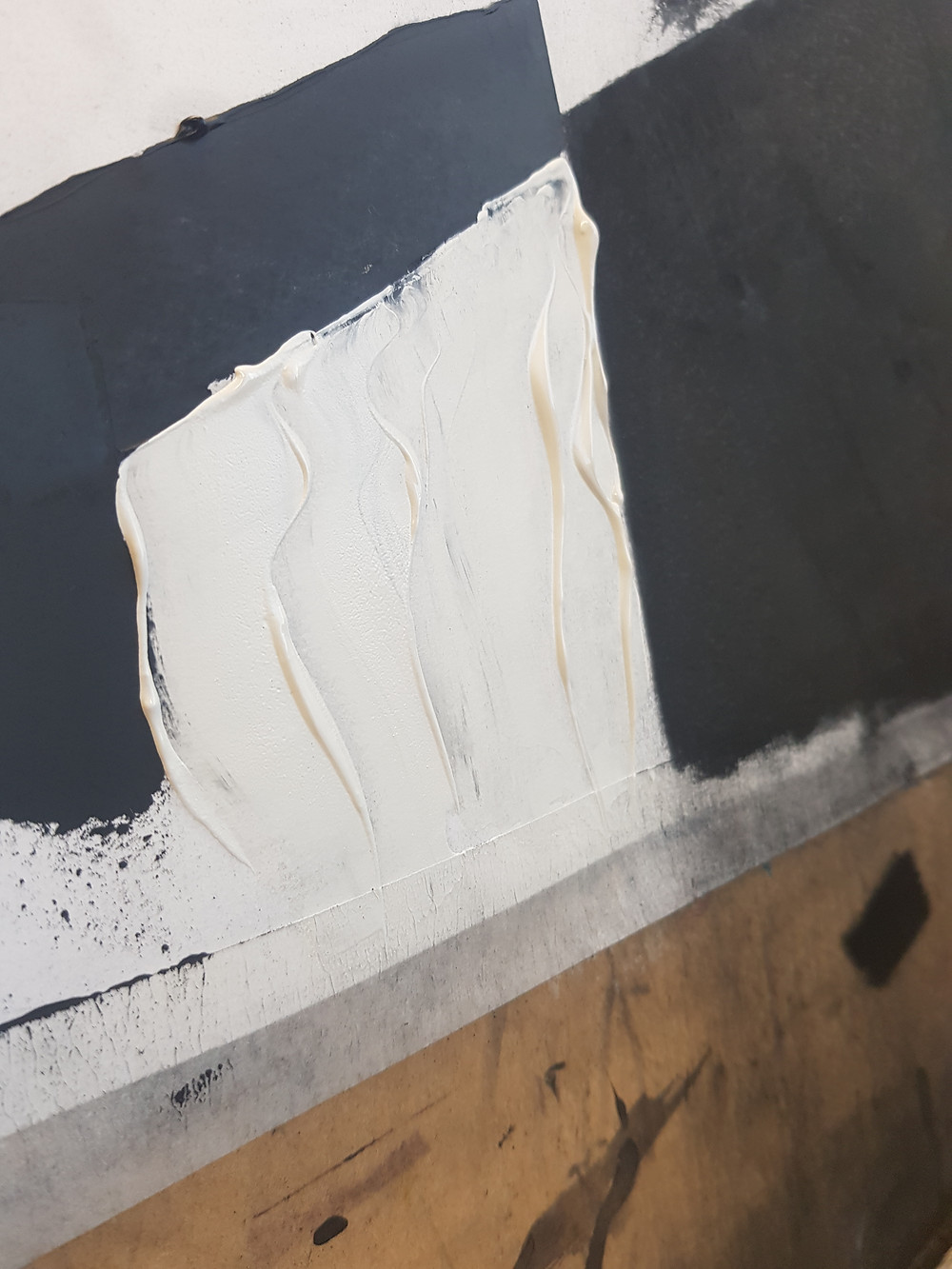 Oil paints curling around the knifes edge when applied