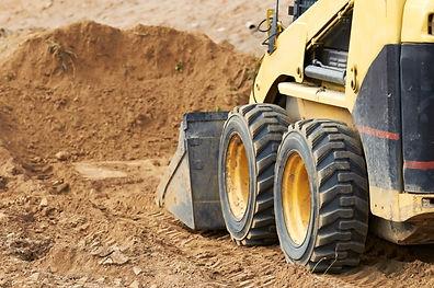 Closeup skid steer loader excavator at r