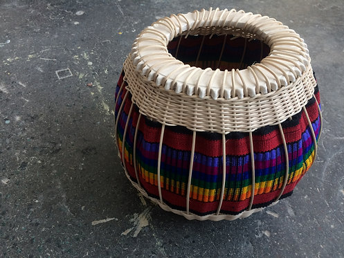 Handmade baskets and combining textiles, finished in ceramic