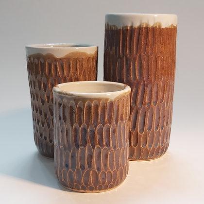 Carved orange blue vase
