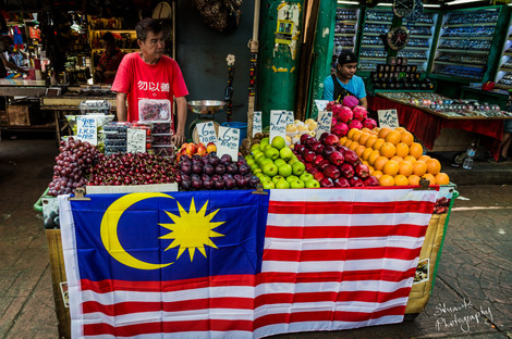 Proud store owner at the markets in KL