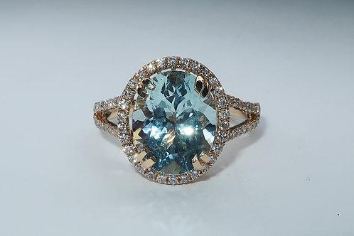 Ladies Halo design Aquamarine and Diamond Ring