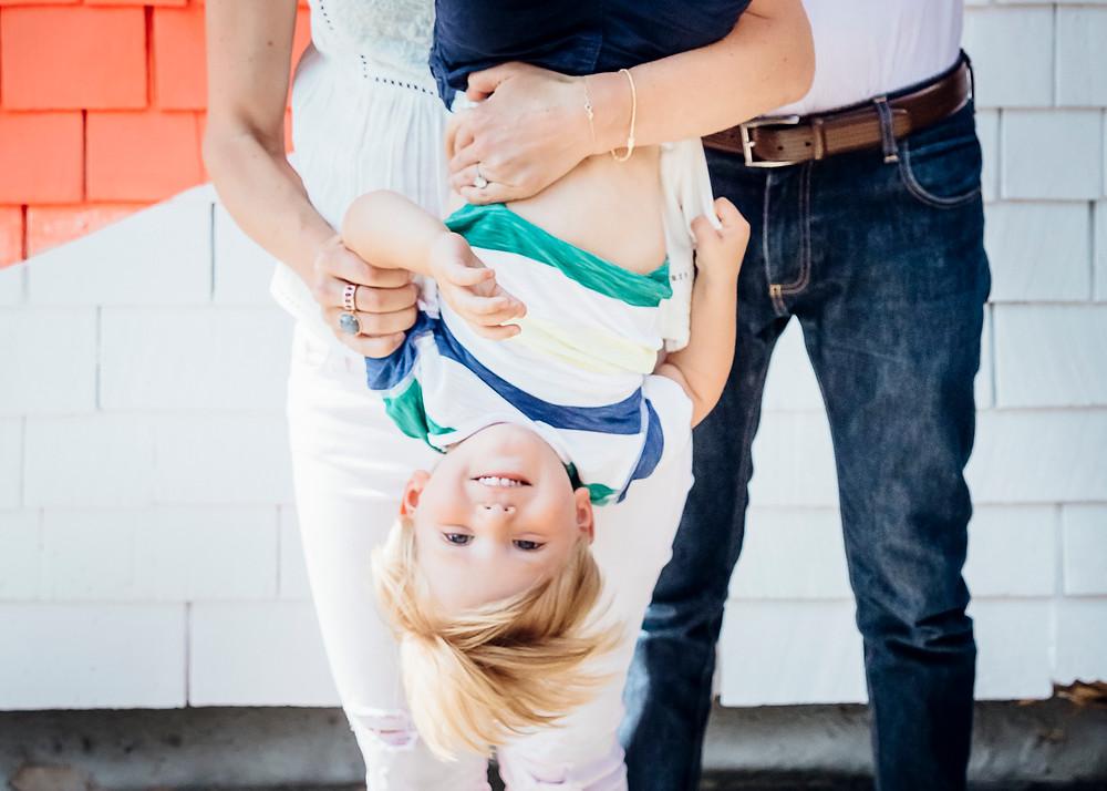 upside down kid in moms arms